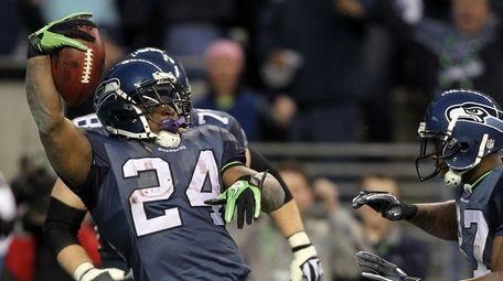Marshawn Lynch of the Seattle Seahawks jumps across