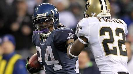 Marshawn Lynch of the Seattle Seahawks runs for