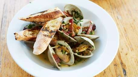 Steamed littleneck clams with chorizo, lemon and parsley