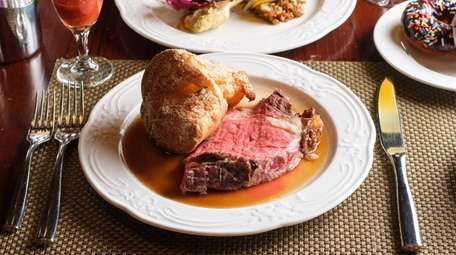 Juicy prime rib and a pop-over at Red