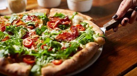 PLT pizza with smoked prosciutto, arugula, cherry tomato,