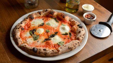 The Margherita D.O.P. with tomato, buffalo mozzarella and