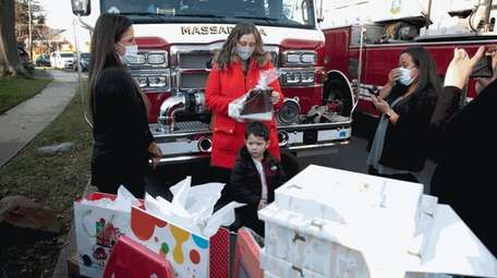 Chrysta Cataldo, left, of Gifting for a Brighter