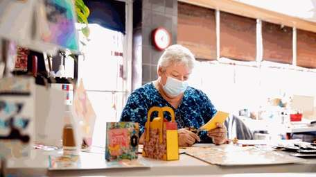 Jean Finfrock, of Brentwood, works on a paper