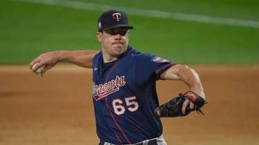 Trevor May of the Minnesota Twins pitches in