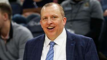 Then-Timberwolves head coach Tom Thibodeau smiles in the