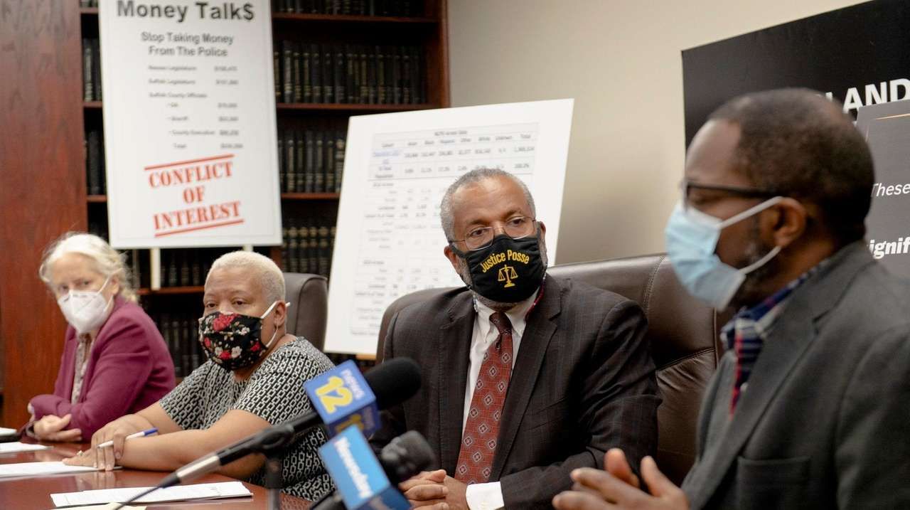 Attorney Frederick Brewington, second from right, during a