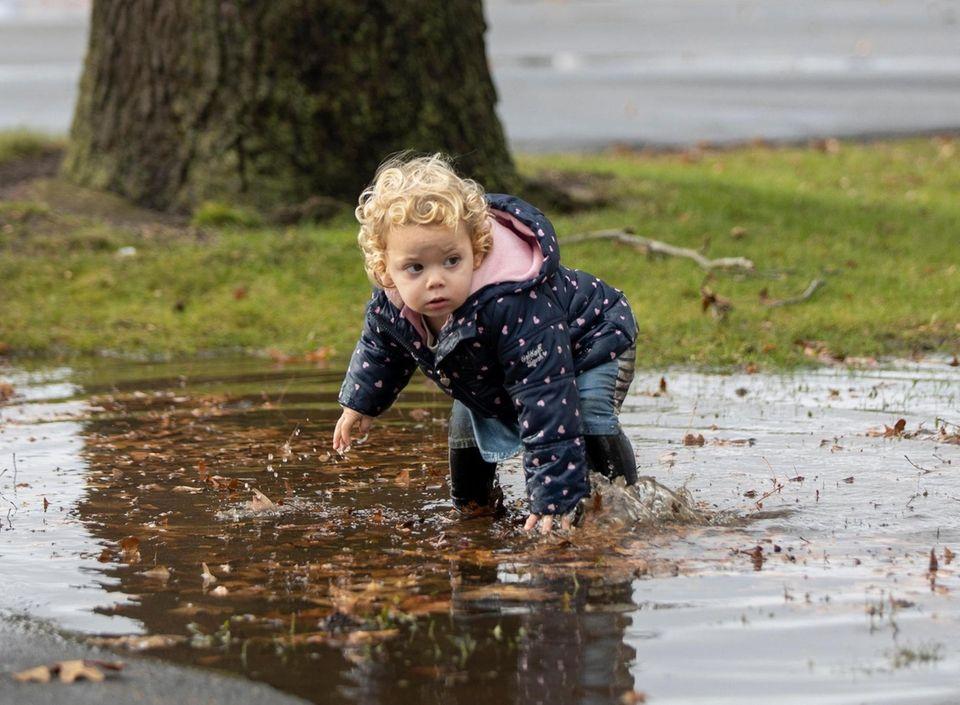 Sarah Newman, 1, West Hempstead, splashes through a