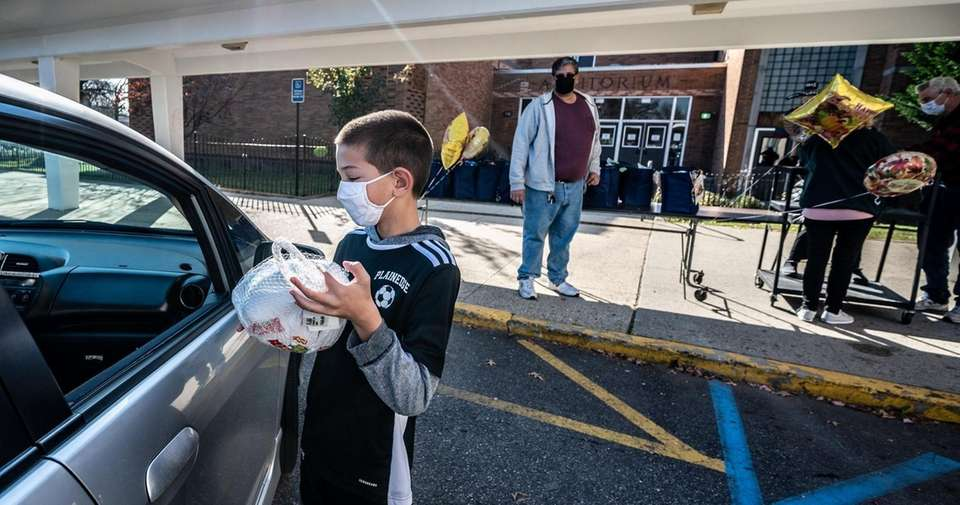 Volunteer Jason Contuniello assisting with the turkey drive