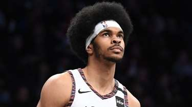 Nets center Jarrett Allen looks on in the