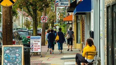 Pedestrians on Main Street in Farmingdale, as seen