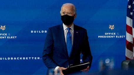 President-elect Joe Biden departs a news conference at