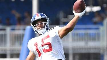Giants wide receiver Golden Tate throws the football