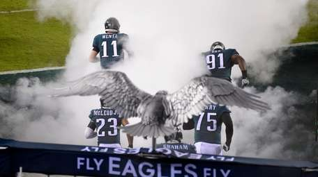 Philadelphia Eagles' Carson Wentz (11) and Fletcher Cox