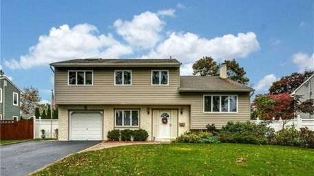 Priced at $774,999, this five-bedroom, 1½-bathroom Colonial on