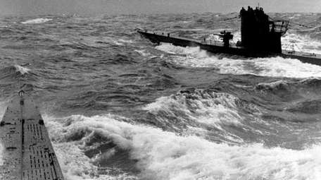 Two German submarines meet as they head toward