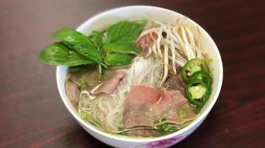 A bowl of beef pho (noodle soup) at