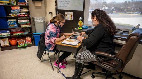 Brianna Clark, 12, works with speech therapist Cathy