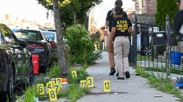 NYPD crime scene investigators work the scene of