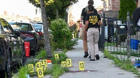 NYPD crime scene investigators work the scene of