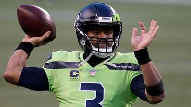 Seahawks quarterback Russell Wilson passes during warmups before