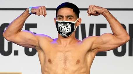 Danny Garcia poses for photos after his weigh-in