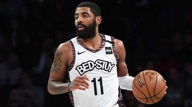 Nets guard Kyrie Irving dribbles the ball up