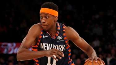 Frank Ntilikina of the Knicks drives to the