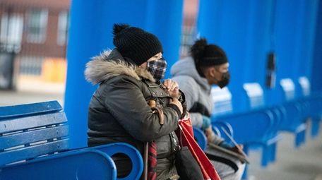 A woman at the bus stop Saturday at