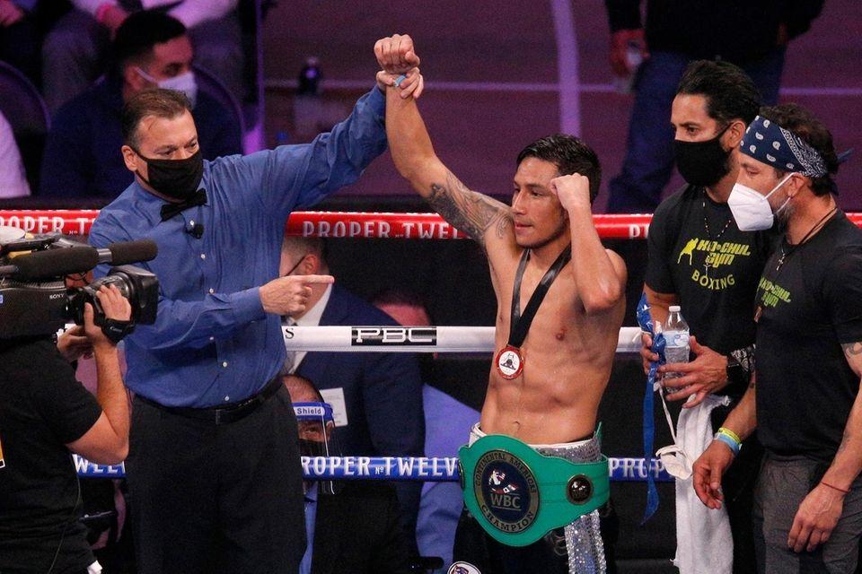 Eduardo Ramirez celebrates after winning a WBA featherweight