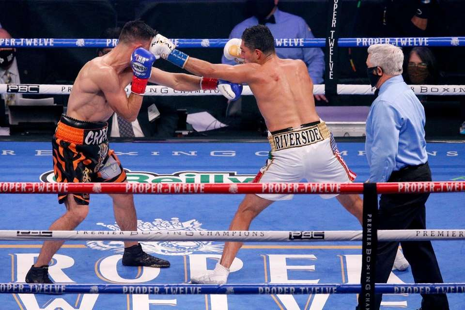 Francisco Santana, left, exchanges punches with Josesito Lopez