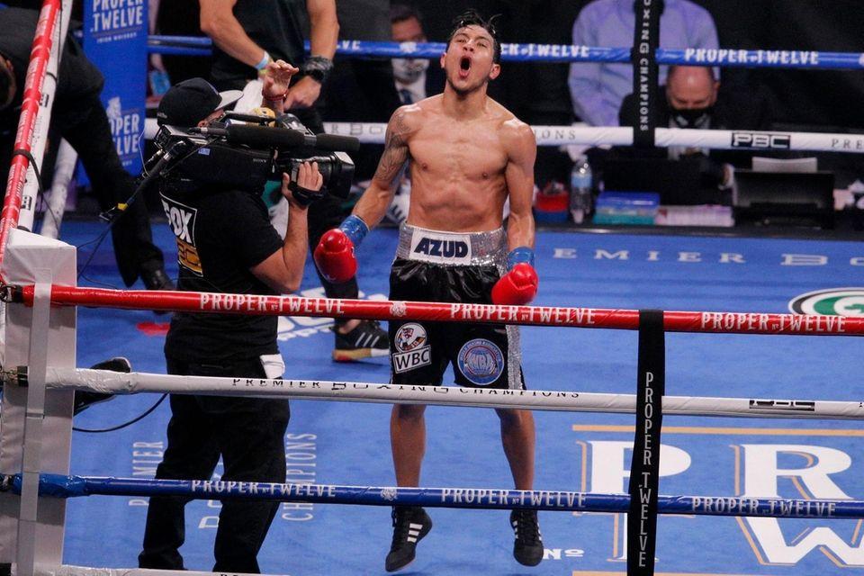 Eduardo Ramirez celebrates after defeating Miguel Flores by