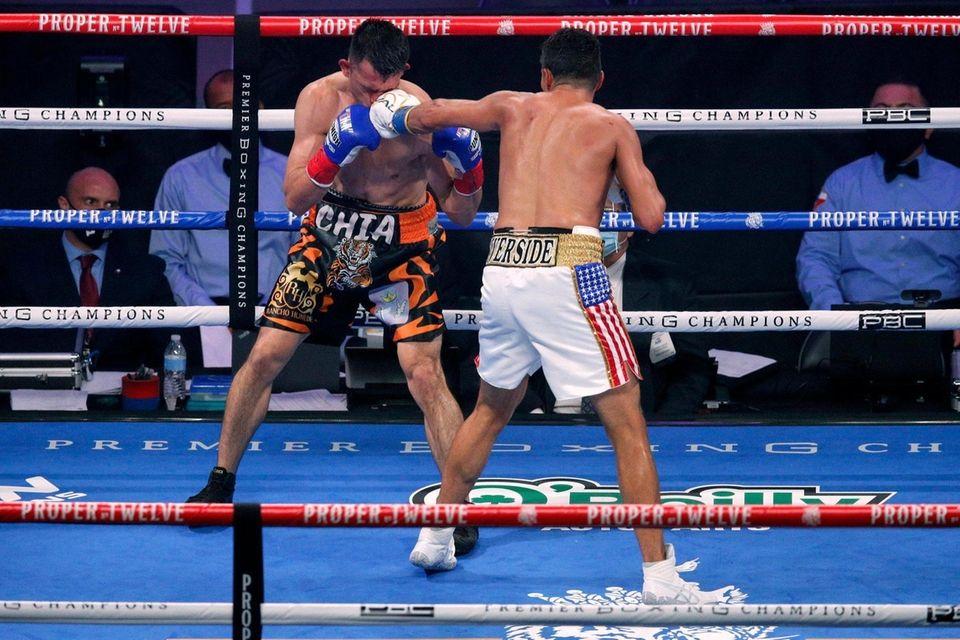Francisco Santana, left, takes a punch from Josesito