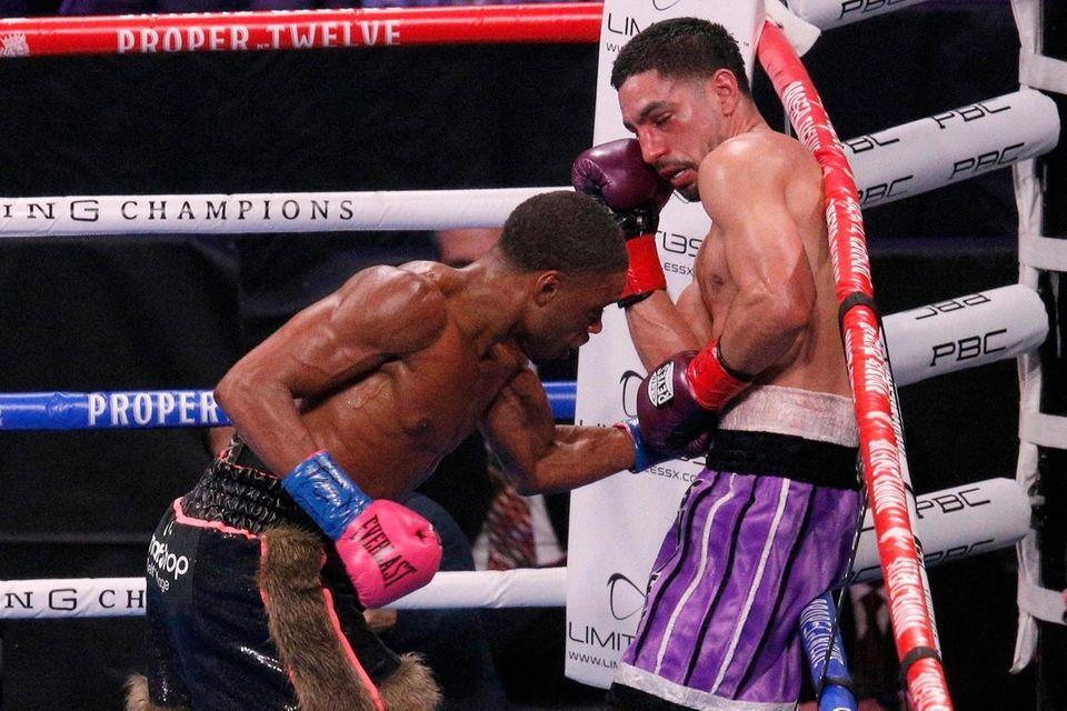 Errol Spence Jr., left, delivers a body punch