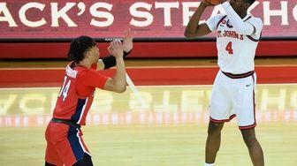 St. John's guard Greg Williams Jr. shoots past