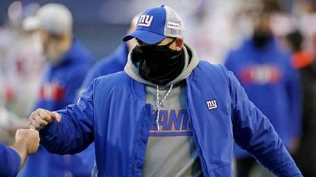 Giants head coach Joe Judge is greeted after