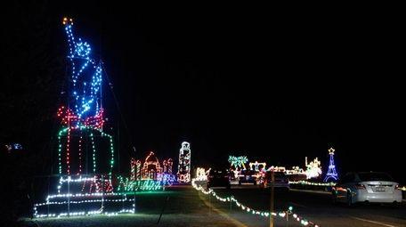 Motorists drive through the Magic Lights show at