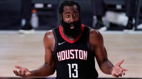 Houston Rockets' James Harden (13) argues a call