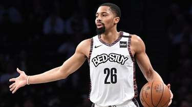 Nets guard Spencer Dinwiddie dribbles the ball up
