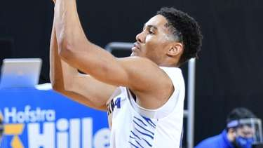 Hofstra's Tareq Coburn launches a three-pointer versus Stony