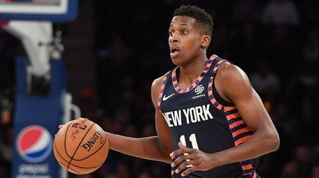 Knicks guard Frank Ntilikina dribbles the ball at
