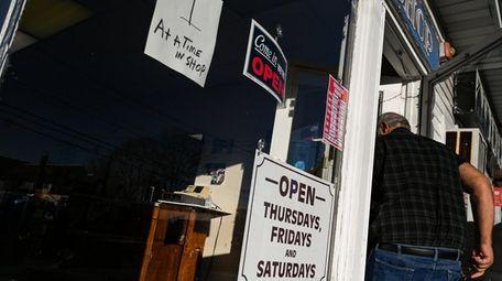 Barber Steve Panaghi walks into his shop along