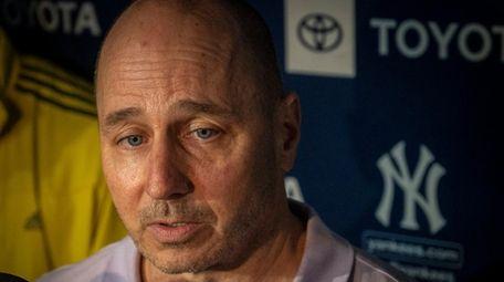 Yankees GM Brian Cashman speaks with members of