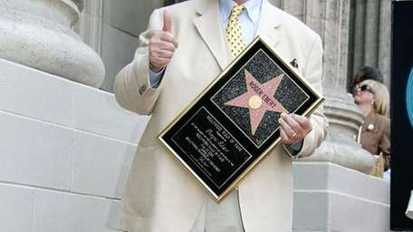 Roger Ebert receiving the 2,288th Star on the