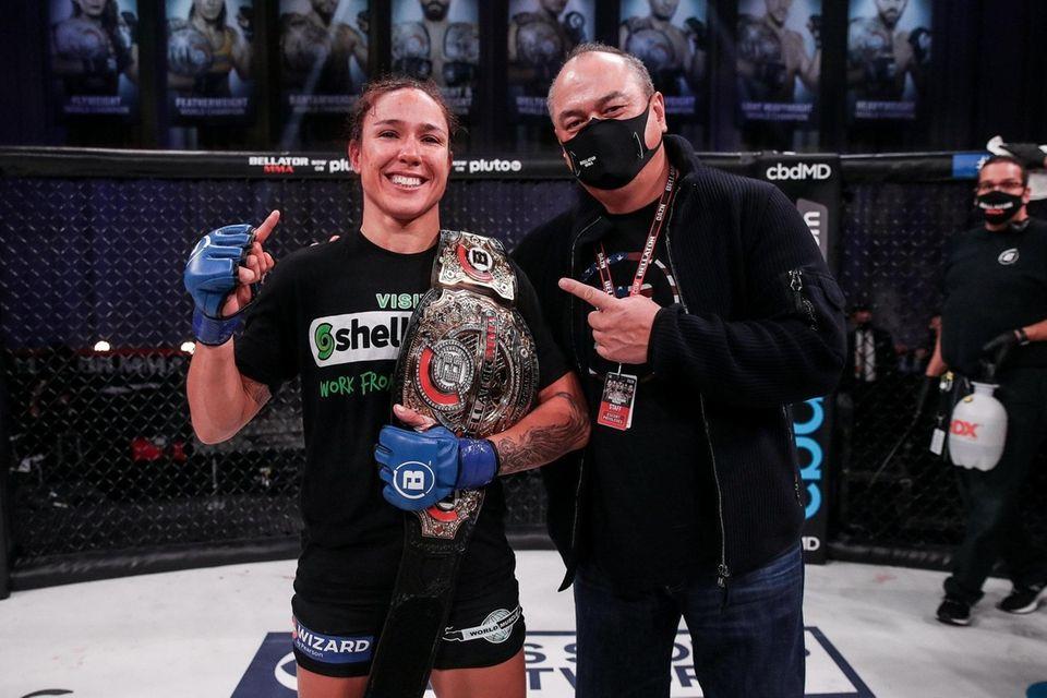 Juliana Velasquez celebrates defeating Ilima-Lei Macfarlane to win