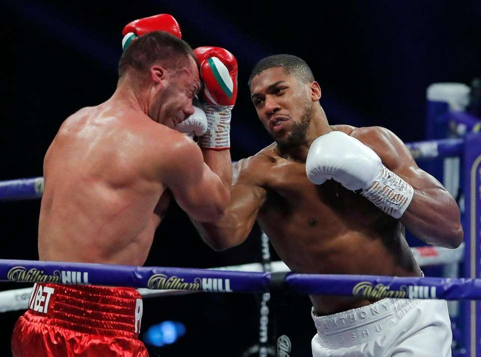 World Heavyweight boxing champion Britain's Anthony Joshua punches