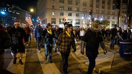 Proud Boys march in Washington, D.C., Saturday night.