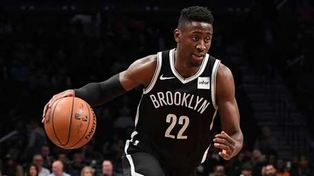 Nets guard Caris LeVert drives the ball against