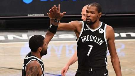 Nets forward Kevin Durant high fives with guard