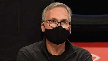 Nets assistant coach Mike D'Antoni looks on during